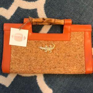Orange and cork bag with dedazzled gator